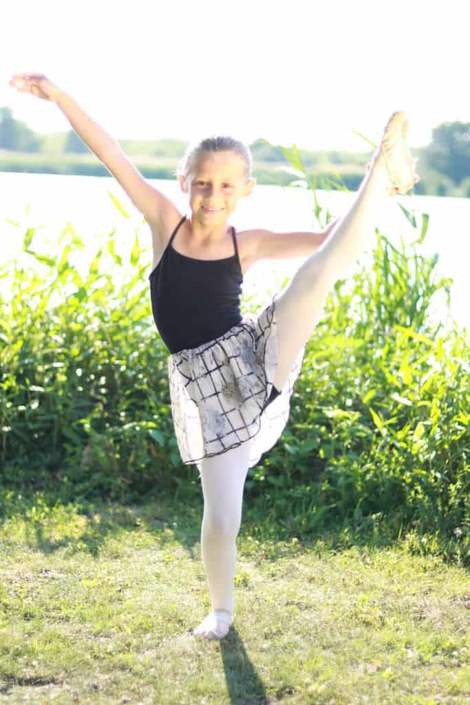 young female dancer showing ballet pose