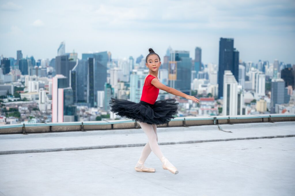 portrait of ballet dancer stretching motion education learning sport with elegance fun performance